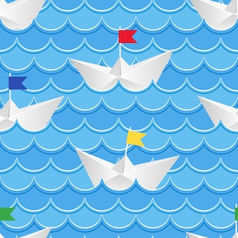 Origami barcos de papel navegando en agua de papel azul.