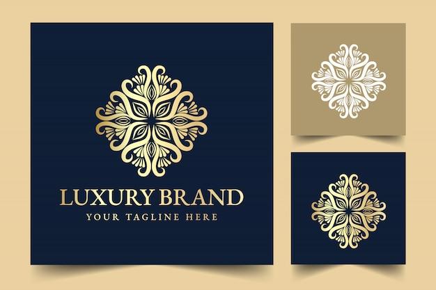 Oro caligráfico femenino floral dibujado a mano monograma heráldico diseño de logotipo de lujo de estilo vintage antiguo