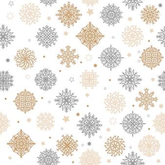 Oro y plata copos de nieve y estrellas de patrones sin fisuras sobre un fondo blanco.