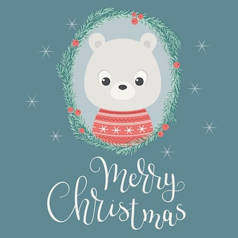 Oso del bebé en una guirnalda de la navidad.