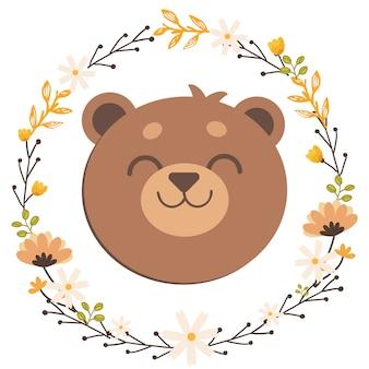 El oso de peluche en anillo de flores