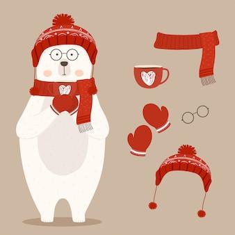 Oso polar lindo que sostiene una taza de café caliente en el invierno.