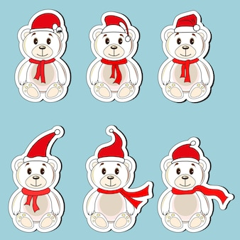 Osos de etiquetas blancas con sombreros navideños de santa claus.