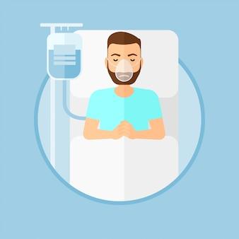 Paciente recostado en cama de hospital con máscara de oxígeno.