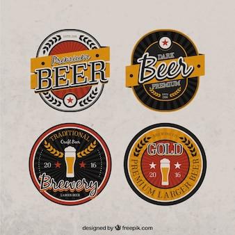 Pack de cuatro emblemas vintage de cerveza