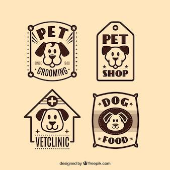 Pack de cuatro logos de perros vintage en diseño plano