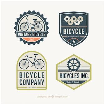 Pack de cuatro insignias de bicicletas en diseño retro