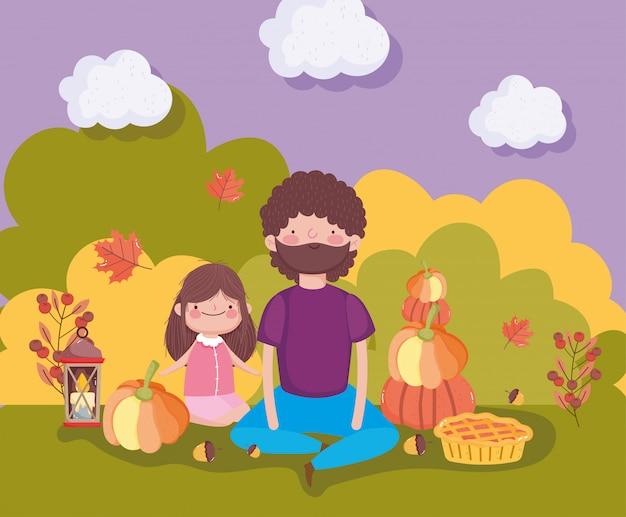 Padre e hija con calabazas pastel vela follaje