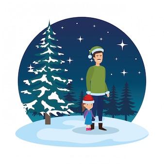 Padre e hija con ropa de navidad en paisaje nevado