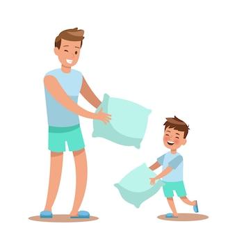 Padre e hijo jugando almohada