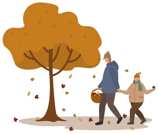 Padre e hijo recogiendo setas en el bosque de otoño
