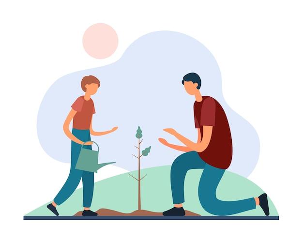 Padre e hijo con regadera plantando arbol