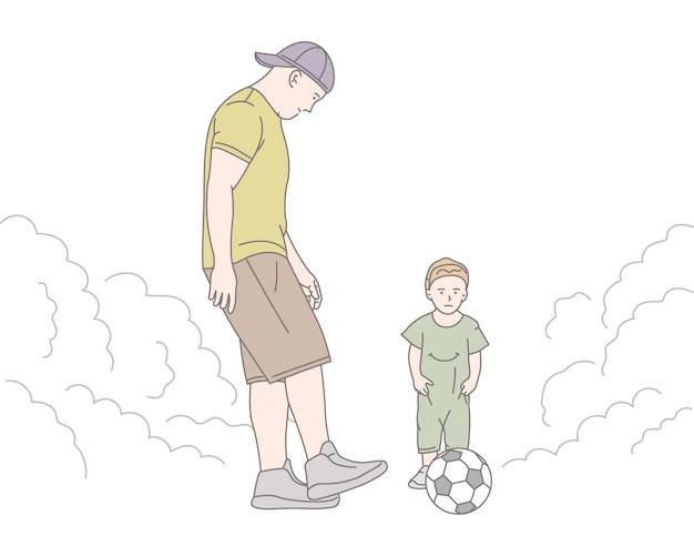 Padre, con, hijo, jugar al fútbol