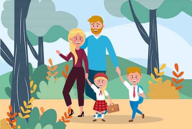Padre y madre con su niña y niño y mochila.