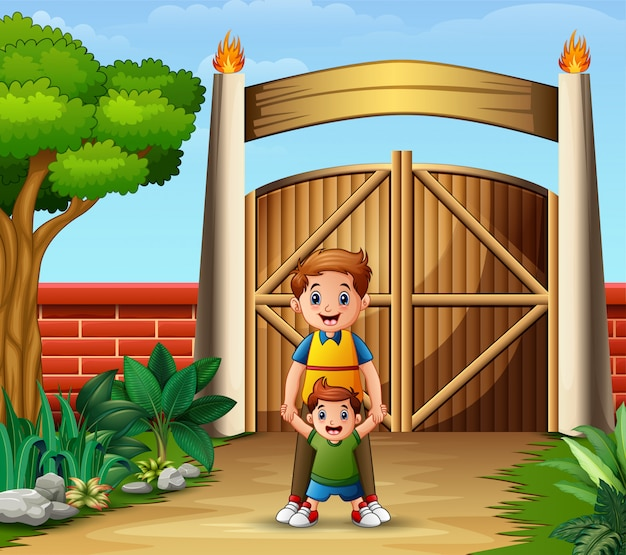 Un padre con su hijo dentro de la puerta.