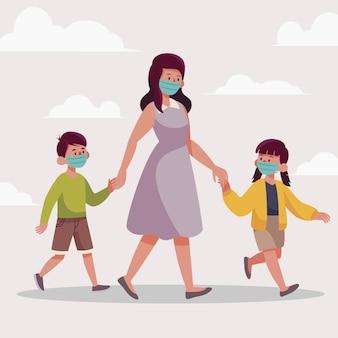 Padres caminando niños con máscaras médicas