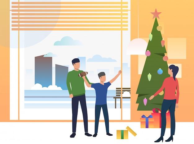 Padres e hijos dando regalos de navidad