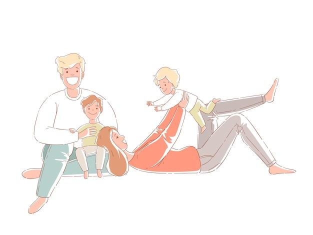 Los padres y los niños están sentados en el suelo. familia feliz