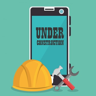 Página web en construcción con teléfono inteligente