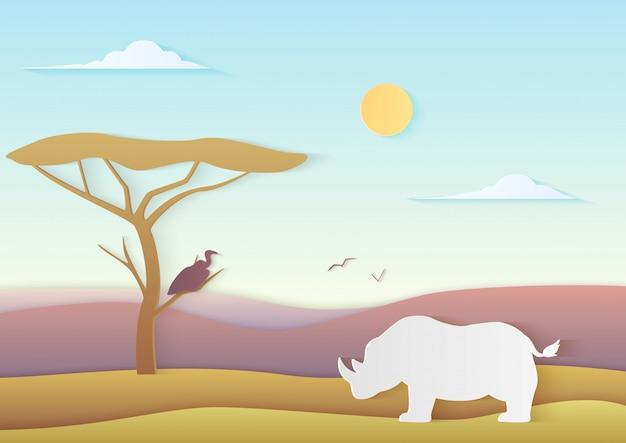 Paisaje africano con rinoceronte y árbol de pie con pájaro en sabana con montañas. el papel de moda cuted la ilustración de la naturaleza de áfrica.