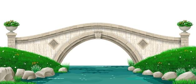 Paisaje y antiguo puente de piedra sobre el río. parque con césped verde y colinas.