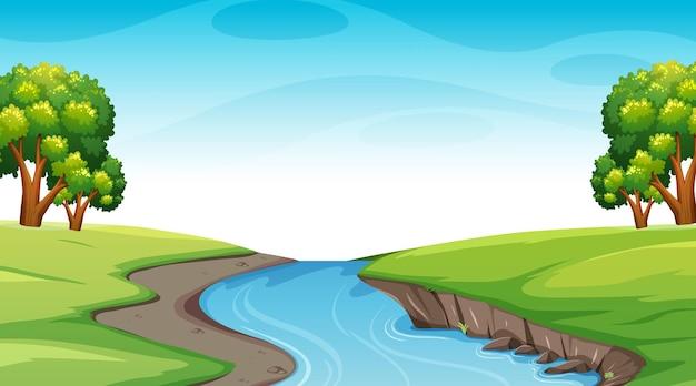 Paisaje de bosque natural en escena diurna con río largo que fluye a través de la pradera
