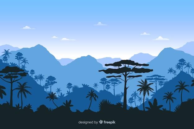 Paisaje de bosque tropical con fondo azul.