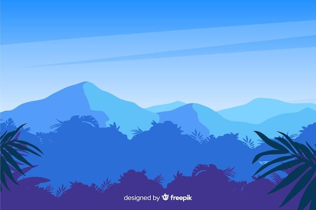 Paisaje de bosque tropical con montañas azules