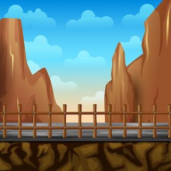 Paisaje de un camino cercas y acantilado con montañas acantilado