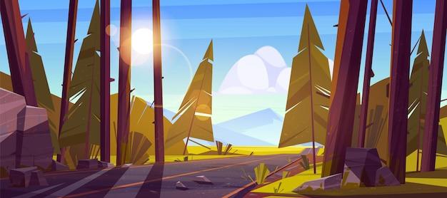 Paisaje con camino a través de bosques y montañas en el horizonte.