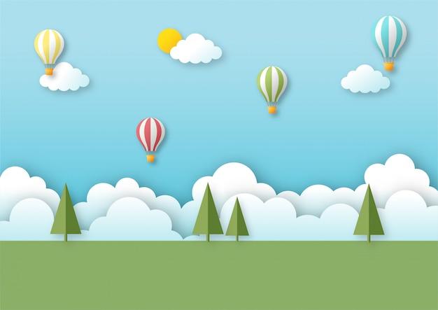 Paisaje de campo con globo volando en el cielo azul. fondo de viaje de arte de papel.