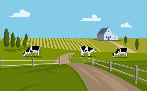 Paisaje de campo con granja y vacas en corral.