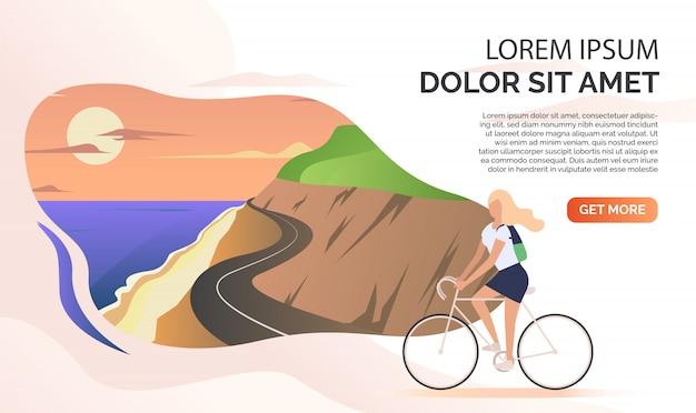 Paisaje, carretera de montaña, océano, mujer montando bicicleta, texto de muestra