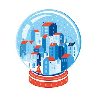 Paisaje de la ciudad de invierno dentro de una bola de cristal de navidad.