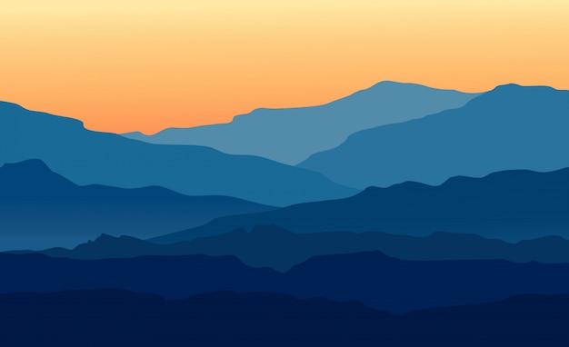 Paisaje con crepúsculo en montañas azules