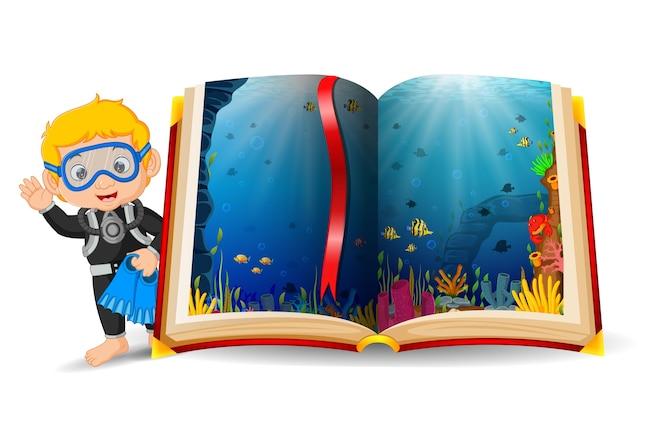 Paisaje del océano en el libro y niño usando un buceo
