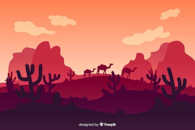 Paisaje desértico con montañas y camellos