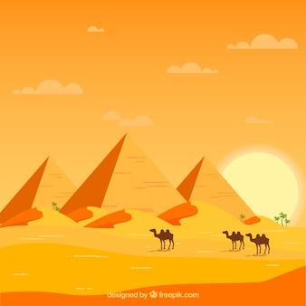 Paisaje de egipto con caravana y pirámides