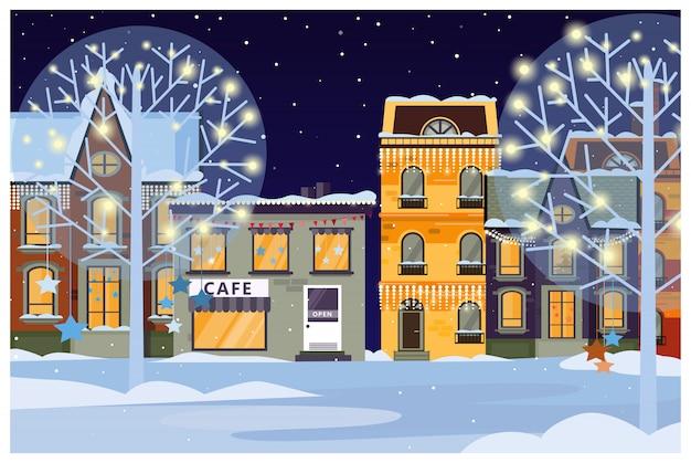 Paisaje invernal con casas y árboles decorados.