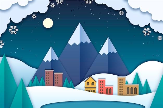 Paisaje invernal en estilo papel con montañas.