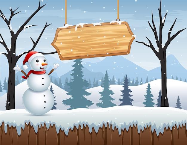Paisaje invernal con muñeco de nieve y cartel de madera.