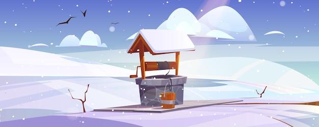 Paisaje invernal con piedra vieja bien en la colina nevada
