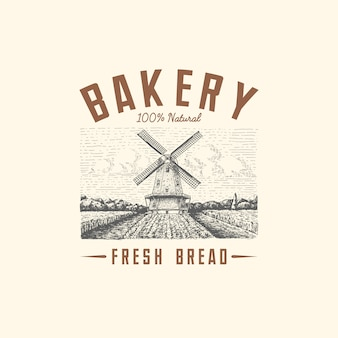 Paisaje del logotipo del molino de viento en estilo vintage, retro dibujado a mano o grabado, se puede utilizar para el logotipo de panadería, campo de trigo con edificio antiguo