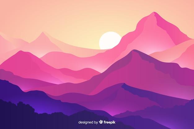 Paisaje de montañas con montañas y puesta de sol