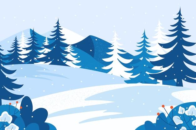 Paisaje con montañas de nieve y árboles.