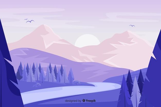 Paisaje de montañas con pinos y puesta de sol