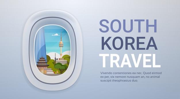 Paisaje de monumentos de corea del sur a través de la ventana del avión