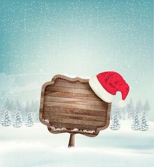 Paisaje de navidad de invierno con un letrero adornado de madera y un fondo de sombrero de santa.