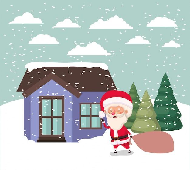 Paisaje de nieve con linda casa y escena de santa claus