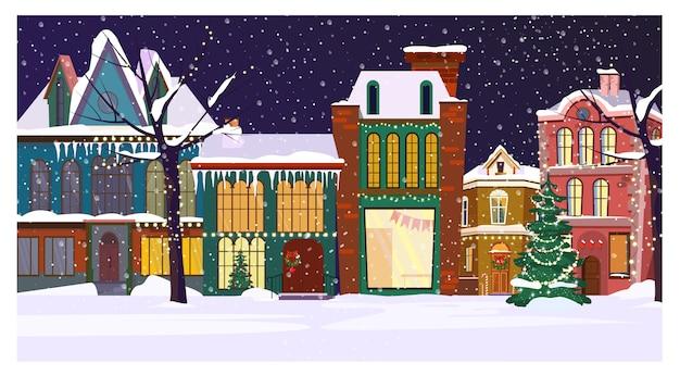 Paisaje de noche de invierno con casas y abeto decorado.